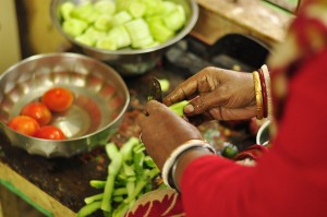 Chopping veggies using only a blade in the Howrah kitchen