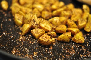 Potatoes covered in spices
